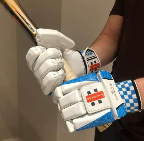 Photo Showing the bat being held in Gray-Nicolls Shockwave Gloves