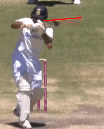A photo of a cricketer demonstrating a top edge